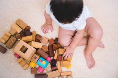 Top view asian child building playing toy blocks wood. Indoors room royalty free stock photos