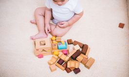 Top view asian child building playing toy blocks wood. Indoors room royalty free stock photography