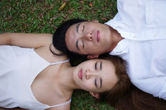 Top view of Asian couple lying on grass Stock Images
