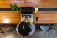 Top view of Asian woman typing computer laptop stock image