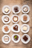 Top view on assorted chocolate pralines on wood Royalty Free Stock Photos