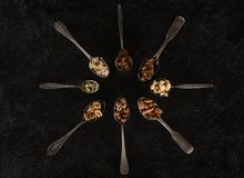 Assorted nuts in spoons Royalty Free Stock Photography
