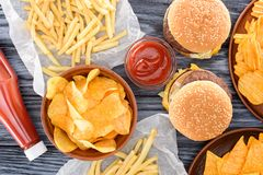 Top view of assorted junk food on wooden. Table stock photo