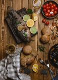 Top view of assorted seafood and baked fish with bread, tomatoes and white wine royalty free stock photography