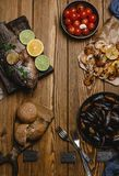 Top view of assorted seafood and baked fish with bread and tomatoes Stock Image