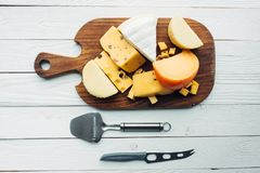 Assorted types of cheese and cutlery Stock Photo