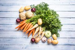 Top of view assortment fresh vegetables on wooden table royalty free stock photo