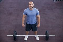 Top view of a athletic man works out at the gym with a barbell stock photos