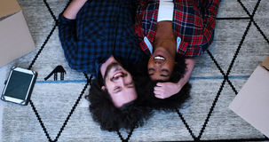 Top view of attractive young multiethnic couple Royalty Free Stock Images