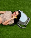 Cheerful lady talking on phone on lawn stock photos
