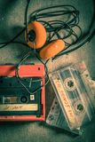 Audio cassette with headphones and walkman on gray table Stock Photos