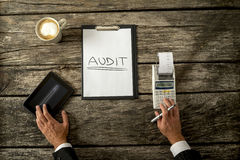Top view of an auditor making calculations Royalty Free Stock Photos