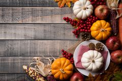 Top view of Autumn maple leaves with Pumpkin, apple, corn stock image