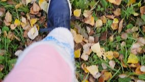 Top of view of autumn season on walking sport shoes in slowmotion. 1920x1080