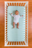 Top view of baby in cot. The top view of baby in cot Stock Images