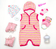 Top view of baby girl clothes and toy stuff. Baby fashion concept Stock Images