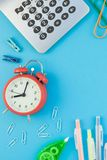 Top view back to school concept. Creative flat lay top view back to school concept with alarm clock, color school and office supplies on bright turquoise paper stock photography
