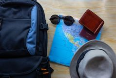 Top view of backpack bag with other travel accessories on woode stock images