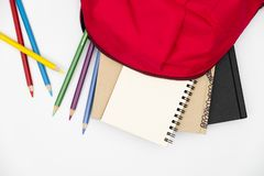 Top view- backpack and school stationery on white background royalty free stock photo