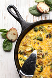 Top view baked egg frittata in cast iron skillet Stock Image