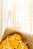 Top view of baked pie with apples on sackcloth on a white wooden background. Rustic style. Fresh bakery. Top view of baked pie with apples on sackcloth on a stock image