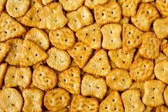 Top view of baked, salted tasty mini pretzels or crackers in different shapes. Food texture background Stock Photography