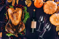 Baked turkey with wine bottle and glasses Royalty Free Stock Photos