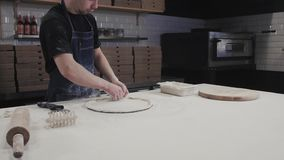 Top view of baker cooking pizza at restaurant for delivery. Pizza ingredients and spices on wooden board in the kitchen. stock footage