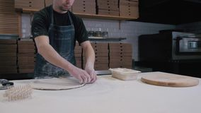 Top view of baker cooking pizza at restaurant for delivery. Pizza ingredients and spices on wooden board in the kitchen. stock video footage