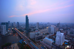 Top view from bangkok sky scrapper looking to the west see taksi. N bridge crossing chaopraya river and sun set sky Stock Photo
