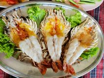 Top view of barbecued shrimp on tray in restaurant, Grilled giant river prawn as a background. Top view of barbecued shrimp on tray in restaurant, Grilled giant stock photos