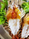 Top view of barbecued shrimp on tray in restaurant, Grilled giant river prawn stock photo
