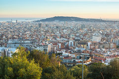 Top view of Barcelona from park Guel on a sunset. Barcelona is the capital city of Catalonia in Spain Royalty Free Stock Photos