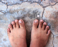 Top View of Bare Foot on Cement Floor Background. Royalty Free Stock Images