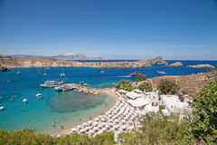 Top view of the bay and harbor. Beach with sun loungers. Top view of the bay and harbor. Beach with sun loungers over the blue lagoon. Arriving and departing stock photography
