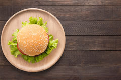 Top view BBQ burger on wooden dish on wooden background. Copy sp Stock Photo