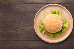 Top view BBQ burger on wooden dish on wooden background. Copy space for your text royalty free stock image
