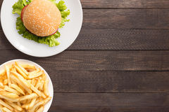 Top view bbq hamburger and french fries on the wooden background stock photography