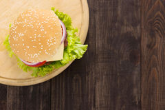Top view bbq hamburger on the wooden background Stock Image