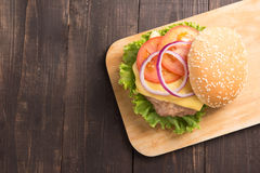 Top view BBQ hamburgers on cutting board on wooden background. Stock Images