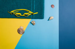 Top view of beach with accessories on colourful graphical background Royalty Free Stock Image