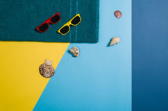Top view of beach with accessories on colourful graphical background Stock Photos