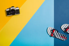 Top view of beach with accessories on colourful graphical background Royalty Free Stock Photography