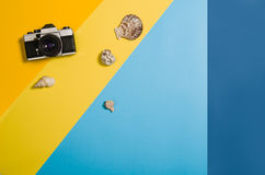 Top view of beach with accessories on colourful graphical background Royalty Free Stock Images