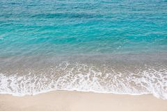 Top view of a beach, ocean waves, sand and water. Top view of a beach, blue ocean waves, sand and water Royalty Free Stock Photos
