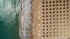 Top view of beach with straw umbrellas. Golden sands, Varna, Bulgaria. Coastline stock photo