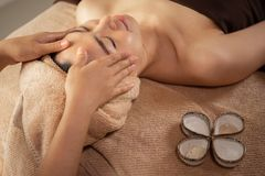 Top view of a Beautiful Asian Female having Spa Treatment. stock photo