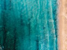 Top view of beautiful beach with turquoise ocean and waves, aerial view. Top view of beautiful beach with turquoise ocean and waves, aerial stock image
