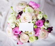 Top view of beautiful bunch of summer flowers with blank card ov Royalty Free Stock Photos