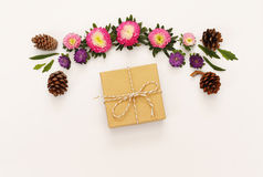 Top view of beautiful flowers and gift box on white background Royalty Free Stock Images